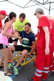 Runner receives medical attention. Paramedic helping male runner wihh accident. ODESSA, UKRAINE - 25 JUN 2017: Runner receives medical attention. Paramedic stock photos