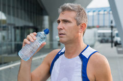 Runner Refreshing After Running royalty free stock photography