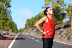 Runner resting tired exhausted after running stock photography