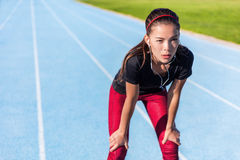 Runner resting tired on running track ready to run Stock Image