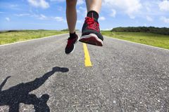 Runner on the road Royalty Free Stock Photography