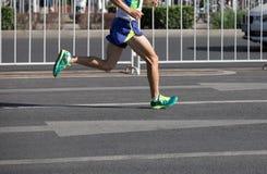 Runner running on city road. Legs of marathon runner running on city road Stock Image