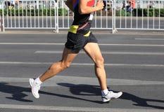 Runner running on city road. Marathon runner running on city road Stock Images