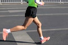 Runner running on city road. Marathon runner running on city road Stock Photography