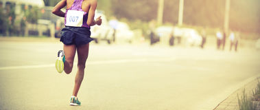 Runner running on city road Royalty Free Stock Photo