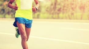 Runner running on city road. Marathon runner running on city road Stock Photo