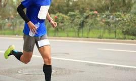 Runner running on city road. Marathon runner running on city road Stock Image