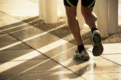 Runner viewing,runner image, runner picture,running,fitness,wellness. Sport. Runner feet running on flooring closeup on shoe Stock Image