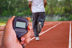 Runner running in the light of evening Stock Photo