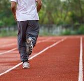 Runner running in the light of evening Stock Photos