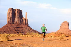 Runner - Running man sprinting in Monument Valley. Runner. Running man sprinting in Monument Valley. Athlete runner cross country trail running outdoors in Royalty Free Stock Image