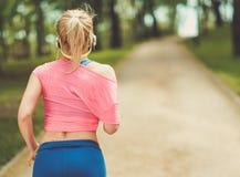 Runner running outdoors Stock Images