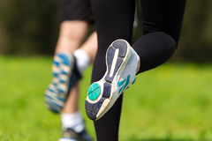 Runner - running shoes closeup of woman and man barefoot running shoes. Royalty Free Stock Photography
