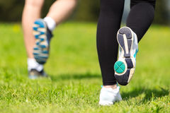 Runner - running shoes closeup of woman and man barefoot running shoes. Stock Images