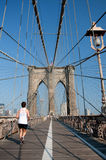 Runner running though Brooklyn Bridge Stock Photos