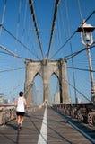 Runner running though Brooklyn Bridge. A person running through Brookly Bridge Stock Photos