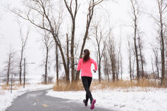 Runner running in winter snow - active lifestyle Royalty Free Stock Photo