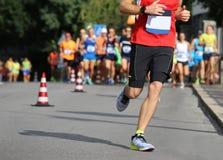 Runner runs the marathon on the city street Stock Photos