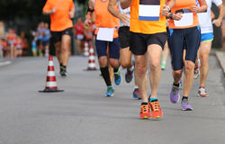 Runner runs the marathon on the city street Stock Photo