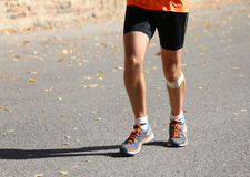 Runner runs with a patch below the knee Royalty Free Stock Image