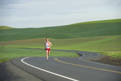 Runner on Rural Road Stock Photos