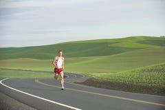 Runner on Rural Road Stock Images
