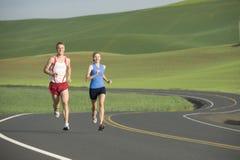 Runner on Rural Road Stock Photo