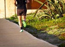 Runner`s Feet on Boardwalk stock images