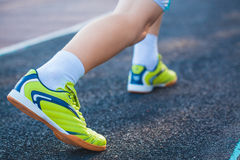 Runner's Feet Running on Stadium Stock Photos