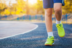 Runner's Feet Running on Stadium Stock Photography