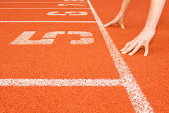 Runner's Hands at the Starting Line Royalty Free Stock Photo