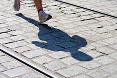 Runner's Shadow Royalty Free Stock Photos