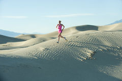Runner on Sand Dunes Stock Photography