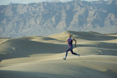 Runner on Sand Dunes. Woman runner on sand dunes royalty free stock photos