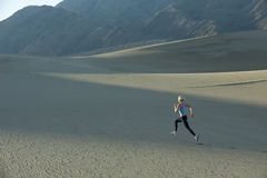 Runner On Sand Dunes Royalty Free Stock Images