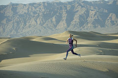 Runner on Sand Dunes Stock Image