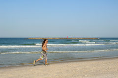 Runner by the sea in Tel-Aviv city Stock Photography