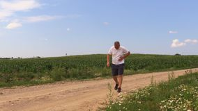 Runner with side pain. In summer day stock video footage