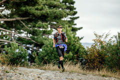 Runner skyrunner with nordic hiking running mountain landscape Stock Photos