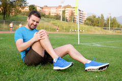 Runner with sport injury Stock Image
