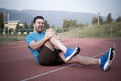 Runner with sport injury Royalty Free Stock Photography