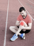 Runner with sport injury Stock Images