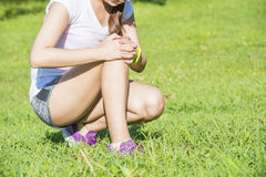 Runner sport knee injury. Woman in pain Royalty Free Stock Images