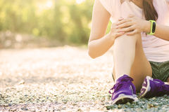 Runner sport knee injury. Woman in pain Royalty Free Stock Photos