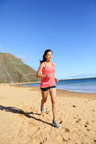 Runner sports athlete running woman on beach Royalty Free Stock Photos