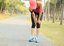 Runner sports injured knee Stock Photo