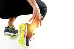 Runner sportsman holding ankle in pain with Broken twisted joint. Running sport injury and Athletic man touching foot due to sprain on white background Royalty Free Stock Images