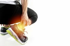 Runner sportsman holding ankle in pain with Broken twisted joint Royalty Free Stock Photos