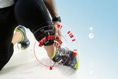 Athletic man touching foot due to sprain with VR medical scannin. Runner sportsman holding ankle in pain with Broken twisted joint running sport injury and Stock Photo