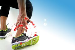 Athletic man touching foot due to sprain with VR medical scannin. Runner sportsman holding ankle in pain with Broken twisted joint running sport injury and Royalty Free Stock Photos